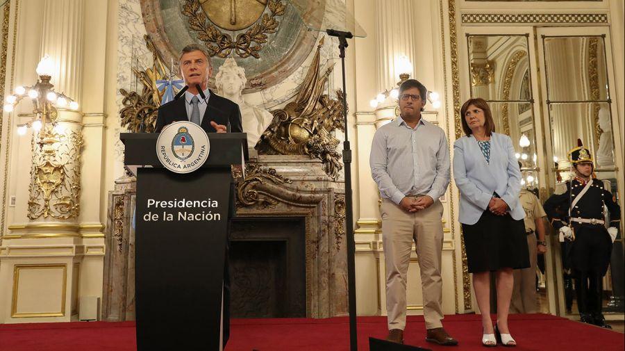 Mauricio Macri junto a los ministros de Justicia, Germán Garavano, y de Seguridad, Patricia Bullrich.