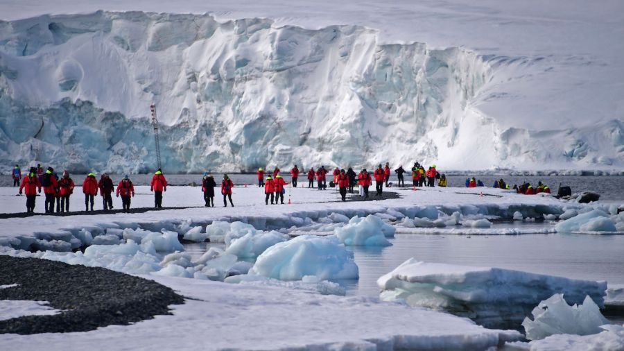 Tourists visit Yankee Harbour Antarctica stock