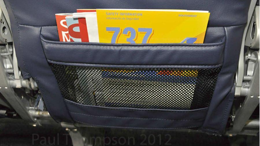 1103_bolsillo_asiento_avion