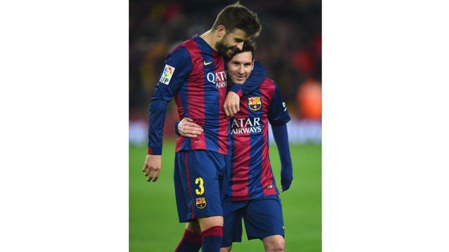 Gerard Pique y Lionel Messi