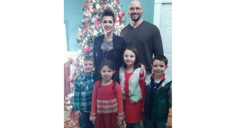 Mel Thompson y sus hijos