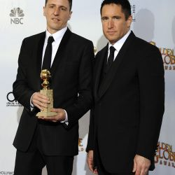 Los músicos Trent Reznor (derecha) y Atticus Ross, ganadores por la mejor banda de sonido en La Red Social – Foto: EFE