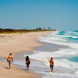 beach_sebastian_inlet_surfers_walking_on_beach