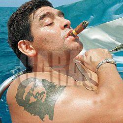 ARGENTINE SOCCER STARDIEGO MARADONA SMOKES A COHIBA AS HE TAKES RIDES A SAILBOAT