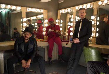 John Legend junto a Ryan Gosling en una escena de La la Land.