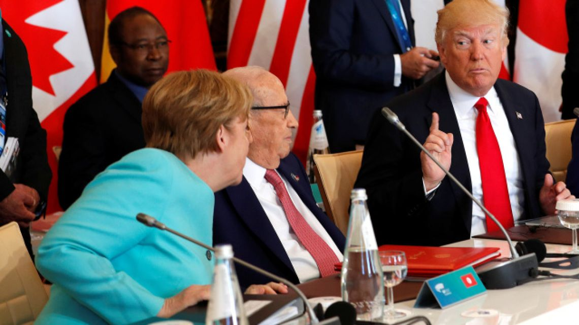 german-chancellor-angela-merkel-sits-next-to-tunisias-president-beji-caid-essebsi-and-speaks-to-us-president-donald-trump-as-they-attend-a-g7-expanded-session-during-the-g7-summit-in-taormina