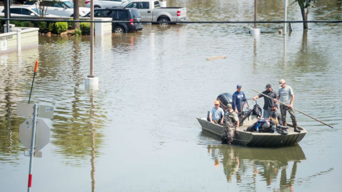 Rescue crews help flood victims in Port Arthur, Texas, yesterday.