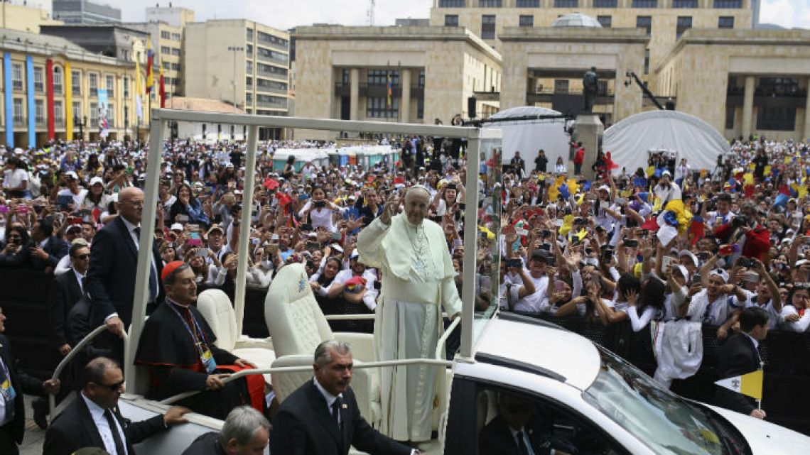 Pope Francis greets the crowd as he arrives at Bolívar Square in Bogotá on Thursday.