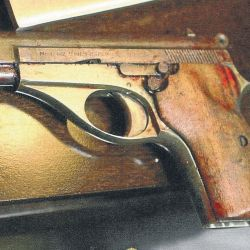 The gun that killed Alberto Nisman, photographed in the immediate aftermath of the late AMIA special prosecutor's death at the scene of the crime.