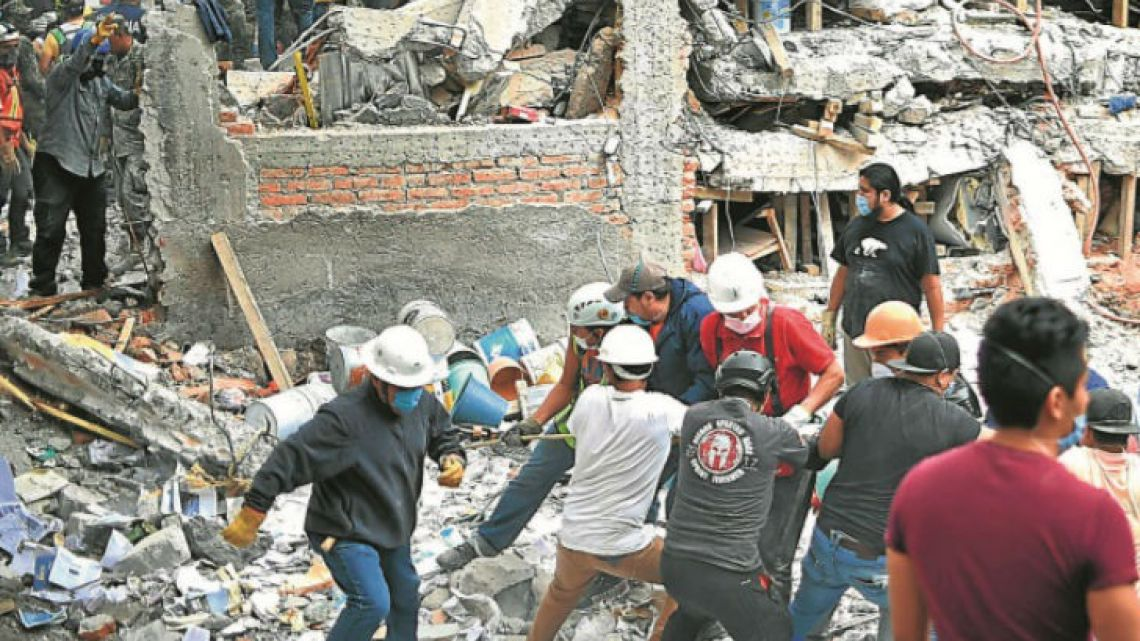 Rescuers, firefighters, policemen, soldiers and volunteers search for survivors in a flattened building in Mexico City on Wednesday, a day after a strong 7.1-magnitude quake hit central Mexico.