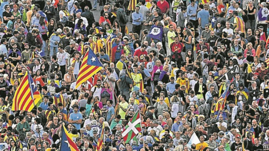 People gather as they wait for the start of the closing meeting of the Catalan pro-independence groups and political parties, ahead of the October 1 referendum, in Barcelona yesterday.