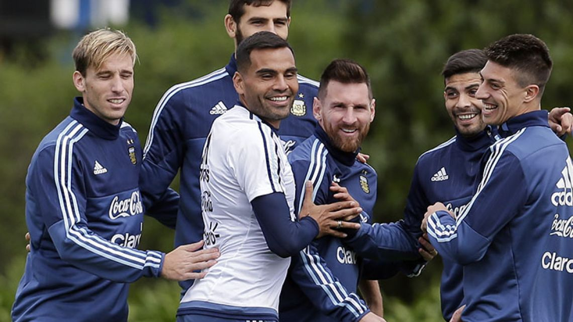 Argentina captain Lionel Messi, centre, shares a lighter moment with his teammates as they train ahead of the team's 2018 Russia World Cup qualifying soccer match against Peru in Buenos Aires, Argentina, Tuesday, Oct. 3, 2017. (AP Photo/Victor R. Caivano)