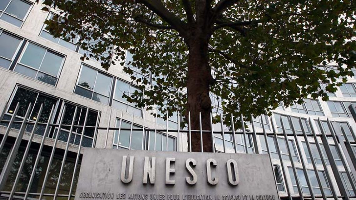 The United Nations Educational Scientific and Cultural Organisation logo is pictured on the entrance at UNESCO's headquarters in Paris