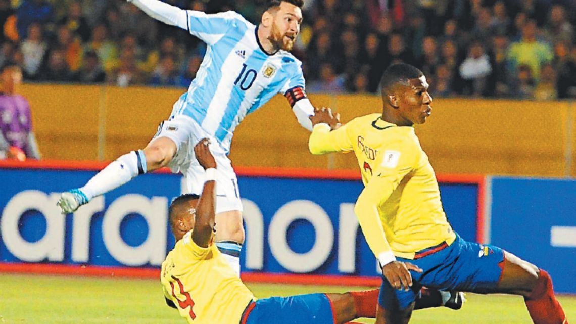 Argentina captain Lionel Messi lobs home his third goal against Ecuador during their 2018 World Cup qualifying football match at the Atahualpa Olympic Stadium in Quito on Tuesday night. Messi's hat-trick secured qualification to Russia 2018.  When it comes to good fortune, or bad, Argentina's luck apparently comes in threes.