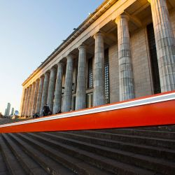 A huge red beam with neon lights designed by Portuguese artist Pedro Cabrita Reis stretches across the steps of the neoclassical building that houses the UBA law faculty, as part of the South American biennale or Bienalsur, in the capital.