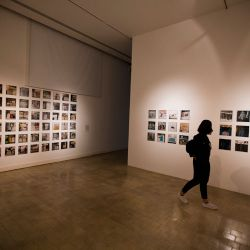 A woman visits a photo exhibit by US artist Zoe Leonard as part of the South American biennale or Bienalsur, at the Museum of Immigrants in Buenos Aires, the biennale's ground zero. A total 379 artworks are being exhibited simultaneously from September to December in museums, cultural centres and public spaces in more than 30 cities and 16 countries worldwide.