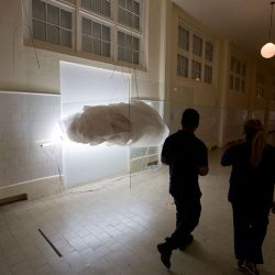 People walk by an art installation by Brazilian artist Jose Bechara as part of the South American biennale or Bienalsur, at the Museum of Immigrants in Buenos Aires.