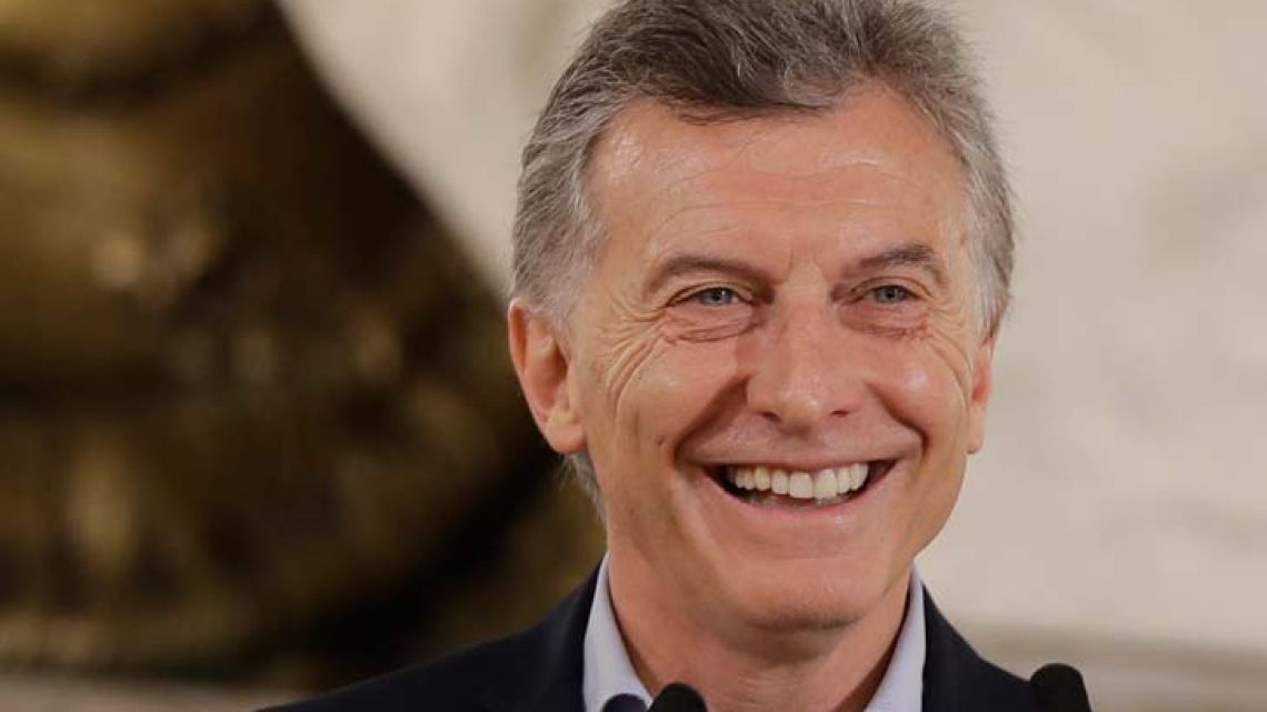 President Mauricio Macri smiles during a press conference at the Pink House in Buenos Aires on Monday morning.