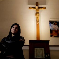 "Yasmin Detez poses for a portrait inside San José Obrero church where Reverend Carlos José celebrated Mass in Caseros, in Buenos Aires province. Detez, 25, says she was abused as a child by the Catholic priest. ""He'd make me sit on his lap and ask me if I had been naughty while he kissed my neck and fondled me,"" Detez said."