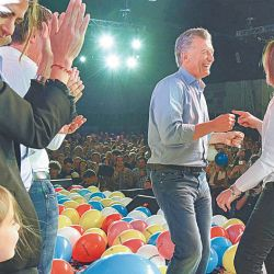 President Mauricio Macri celebrates with Buenos Aires Province Governor Maria Eugenia Vidal onstage, at the election night rally at the Cambiemos bunker in Costa Salguero.