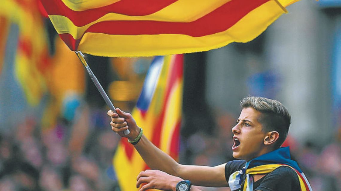 Pro-independence supporters flooded the streets of Catalonia yesterday after the Parliament voted to break away from Spain and proclaim a republic.