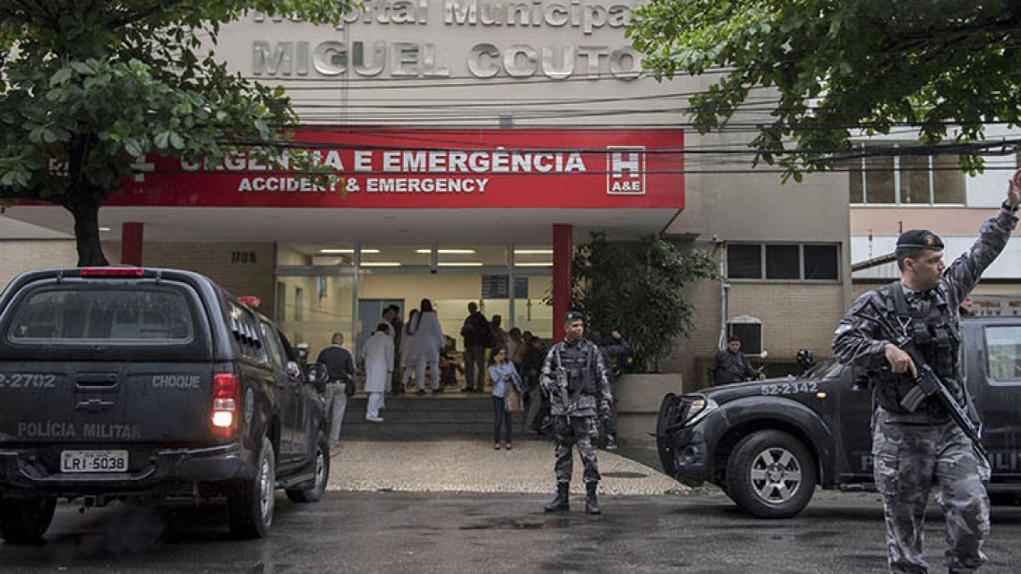 Policemen stand guard at the entrance of the Miguel Couto Hospital in Rio de Janeiro, where a Spanish tourist was taken after being shot dead accidentally by police while visiting the Rocinha favela on October 23.
