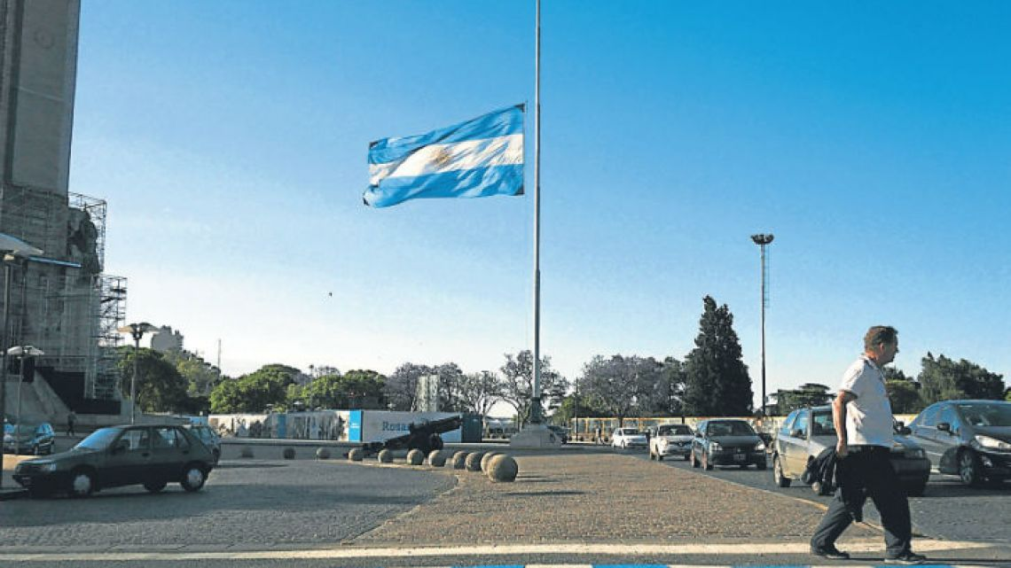 The national flag flies at half-mast in Rosario on Thursday.