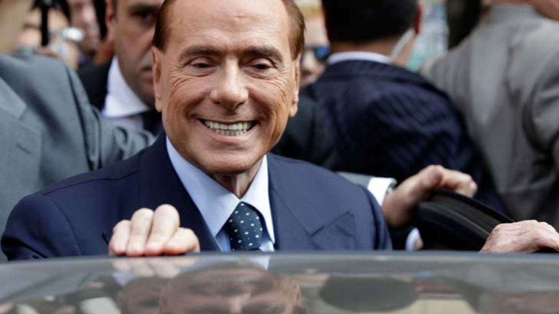 Former Italian Premier and Forza Italia (Go Italy) leader Silvio Berlusconi smiles as he leaves at the end of a press conference in Milan, Italy. (AP Photo/Luca Bruno, files)