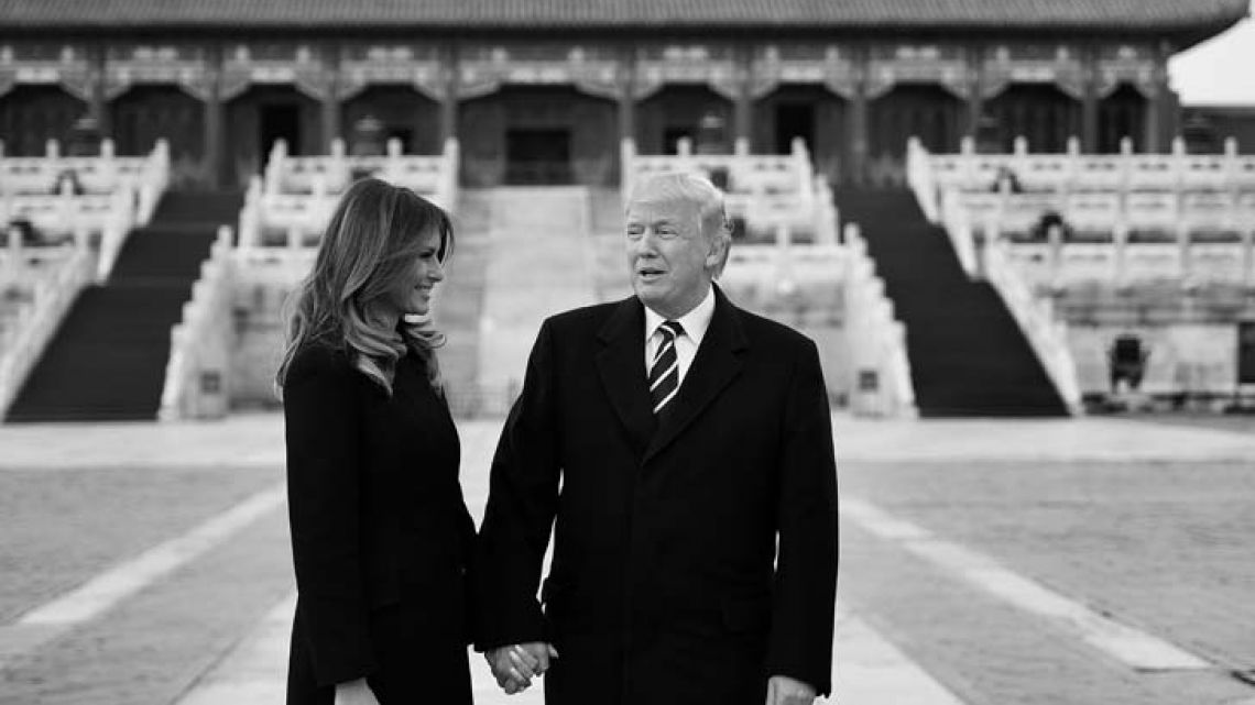 US President Donald Trump holds hands with First Lady Melania Trump in the Forbidden City in Beijing yesterday.