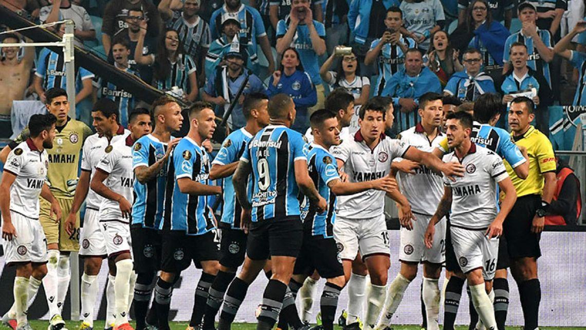 Gremio and Lanús players argue at the end of their 2017 Copa Libertadores first leg final match at Arena Gremio stadium, in Porto Alegre, Brazil. Gremio won 1-0.