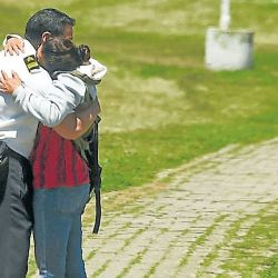A relative and a comrade of one of the 44 crew members of the missing ARA San Juan submarine embrace each other in grief at the Navy base in Mar del Plata.
