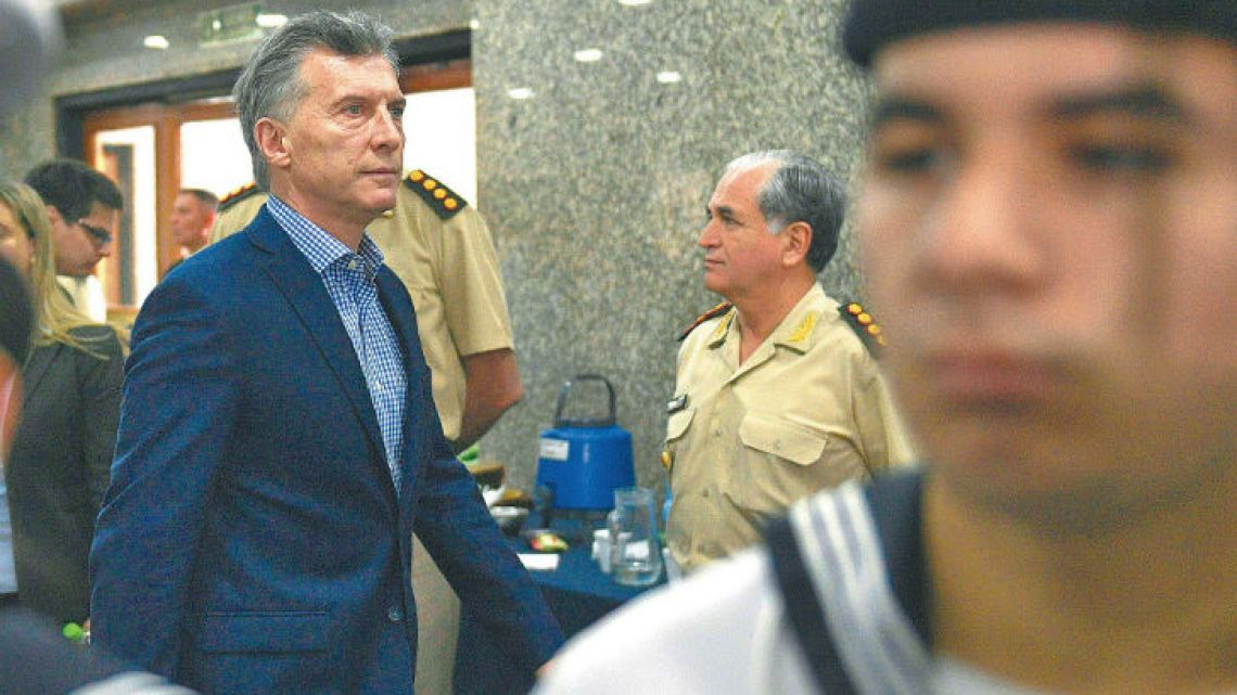 President Mauricio Macri arrives at Armada's offices for a press conference.