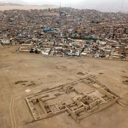 Homes in the Lurin district stand near the pre-Columbian archeological site Pachacamac in Lima, Peru. Many people in modern-day Peru recall treasure hunting at ruins as children, hiding away pieces of ceramic pots, textile scraps and even human bones.