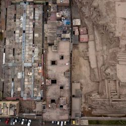 The pre-Columbian archeological site Huantille, right, is hugged by apartments a market in the Cercado de Lima area of Lima, Peru. Many residents of Peru's capital live among remnants of the vast Inca empire that flourished here more than six centuries ago.