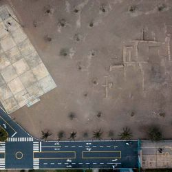 A municipal basketball court that was built near the pre-Columbian archeological site Limatambo in Lima, Peru. Thousands of historic sites are being crowded out or destroyed as roads, universities, stadiums and neighbourhoods are built to meet the population's growing demands.