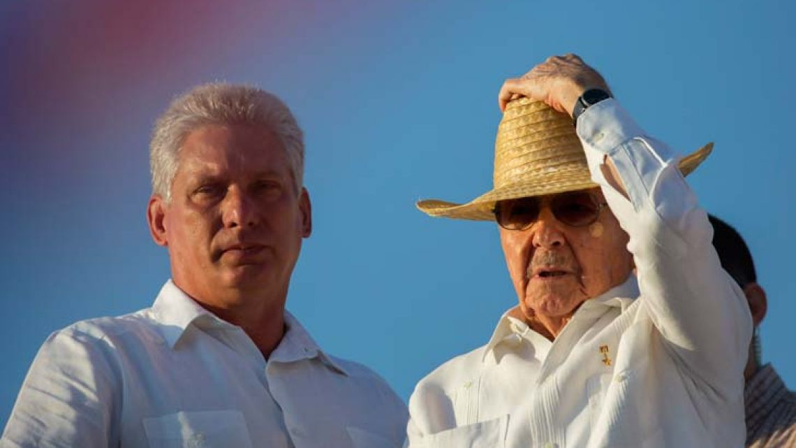 Cuba's First Vice-President Miguel Díaz-Canel, left, stands with President Raúl Castro during the May Day parade in Havana, Cuba.