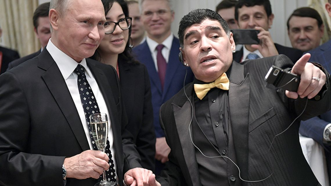 Russian President Vladimir Putin and Argentinian soccer legend Diego Armando Maradona talk prior to the 2018 soccer World Cup draw in the Kremlin in Moscow on Friday December 1, 2017.