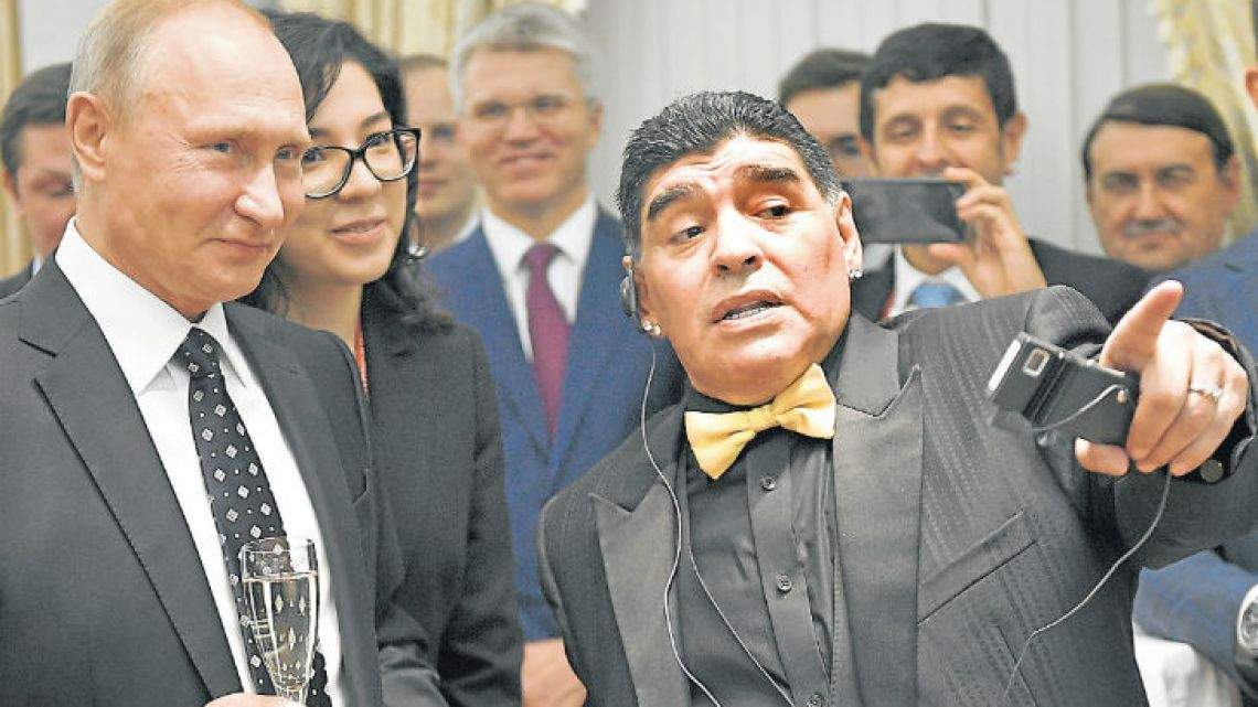 Russian President Vladimir Putin talks to Diego Maradona at the 2018 World Cup draw in the Kremlin in Moscow.