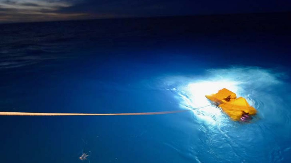 This handout photo released by the US Navy on December 9, 2017 shows their research vessel R/V Atlantis deploying the cable-controlled Undersea Recovery Vehicle (CURV-21) off the coast of Comodoro Rivadavia, Argentina.