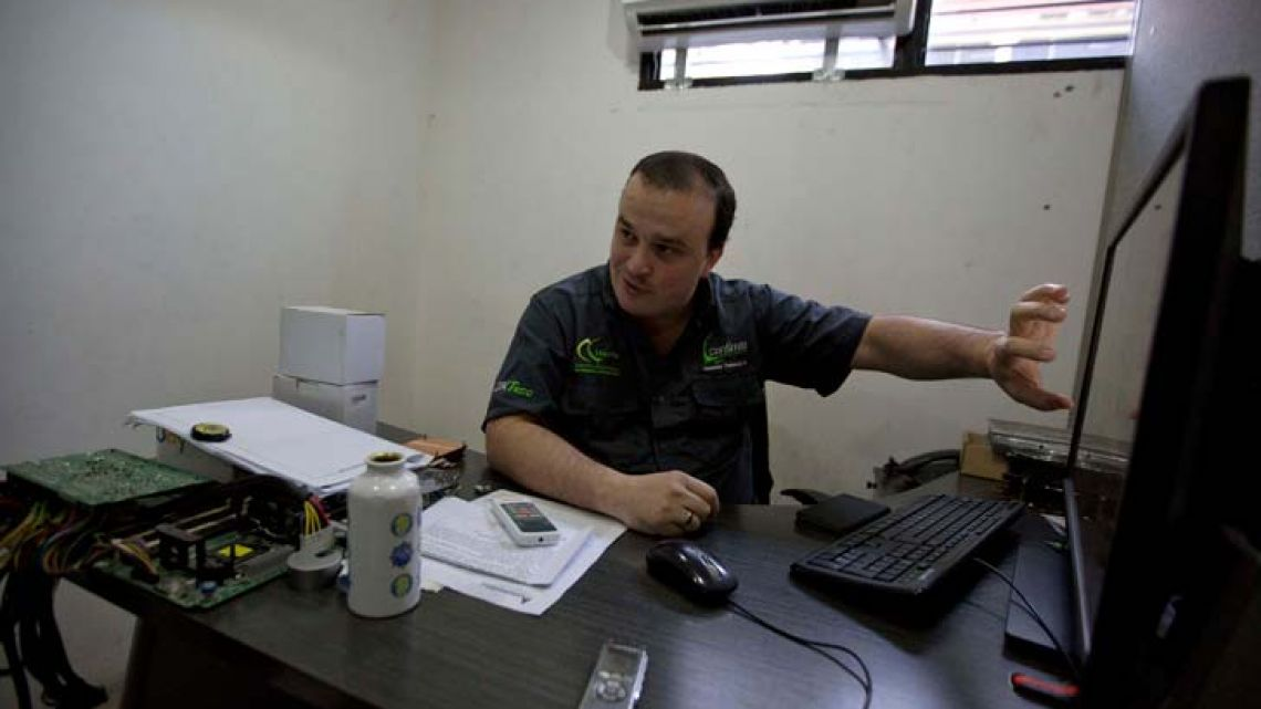 John Villar speaks during an interview at his office in Caracas, Venezuela. In the last month, Villar has bought two plane tickets to Colombia, purchased his wife's medication and paid the employees of his start-up business in Venezuela – all in bitcoin.