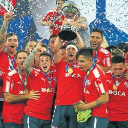 Independiente's players celebrate as they receive the Copa Sudamericana trophy