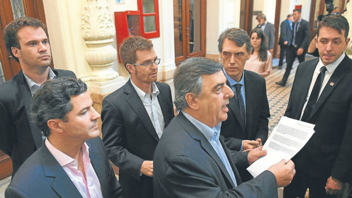 Cambiemos Lower House lawmakers including Mario Negri, Luciano Laspina and Nicolás Massot deliver a statement to the press yesterday about their meeting with governors concerning the controversial pension reform.