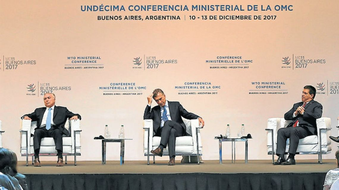 Leaders, from left, Uruguay's President Tabaré Vázquez, Brazil's President Michel Temer, President Mauricio Macri, Paraguay President Horacio Cartes and Director General of the WTO, Roberto Azevedo, attend the opening ceremony of the WTO Ministerial Conference in Buenos Aires.