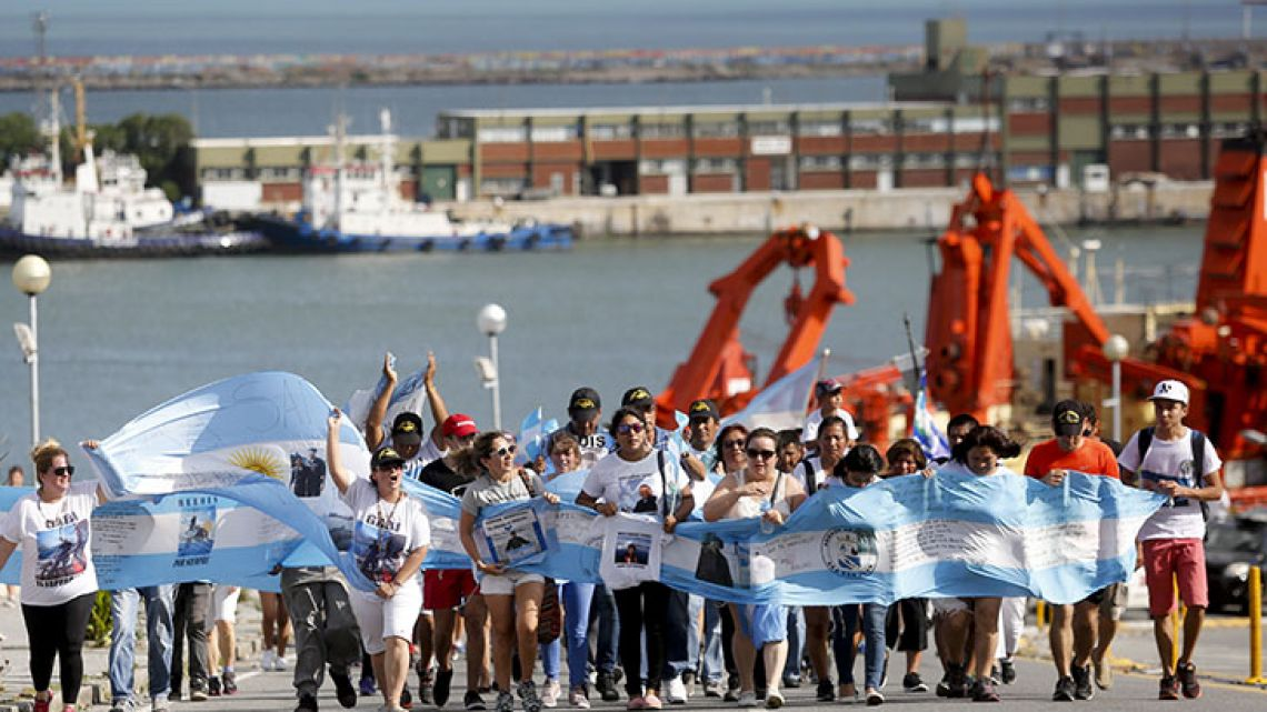 Families of the 44 crew members of the submarine ARA San Juan march on the naval base in Mar del Plata on Friday, marking one month since the disappearance of the vessel.