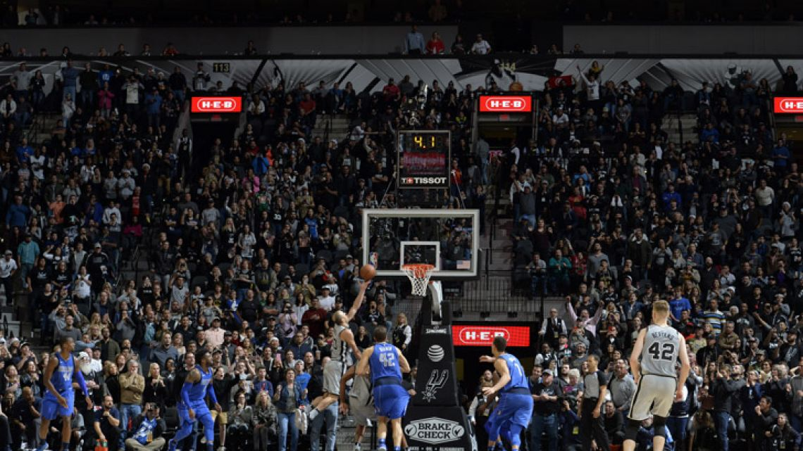 Manu Ginobili (#20) of the San Antonio Spurs shoots o win the game against the Dallas Mavericks on December 16 at the AT&T Center in San Antonio, Texas.