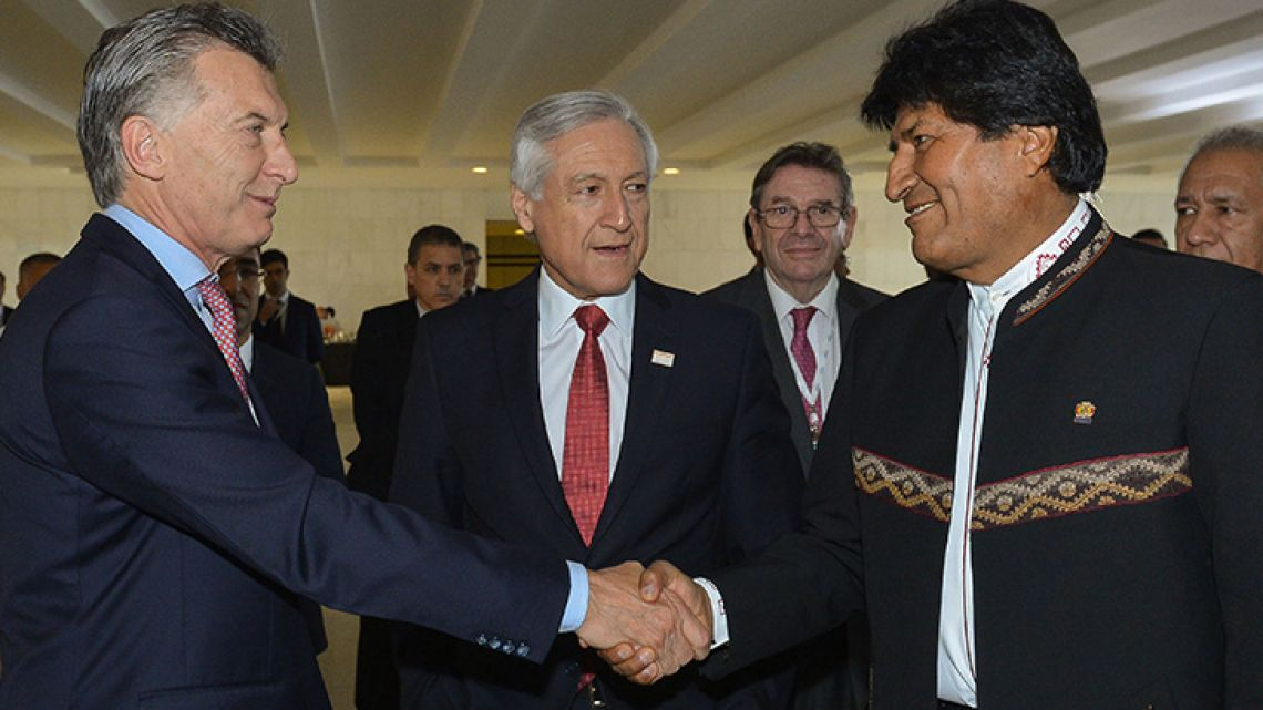 Argentina's President Mauricio Macri shakes hands with his Bolivian counterpart Evo Morales in Brasilia, Brazil, on Thursday December 22.