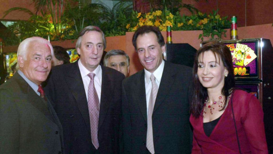 Businessman, media mogul and gaming tzar Cristóbal López (second from right) poses for a photograph with former president Néstor Kirchner (second from left) and former president Cristina Fernández de Kirchner (far right) inside a casino. To the far left is Juan Castellanos Bonillo, a business parter of López.