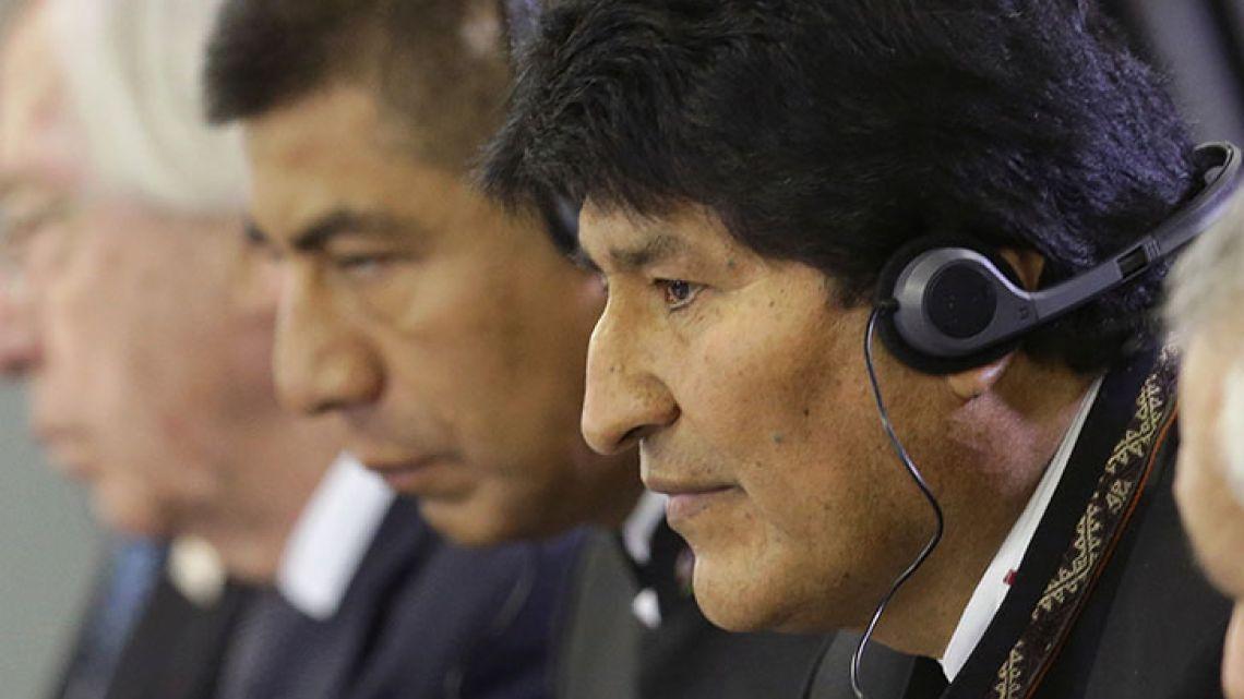 Bolivia President Evo Morales listens in on talks at the Mercosur Summit in Brasilia in December, 2017.