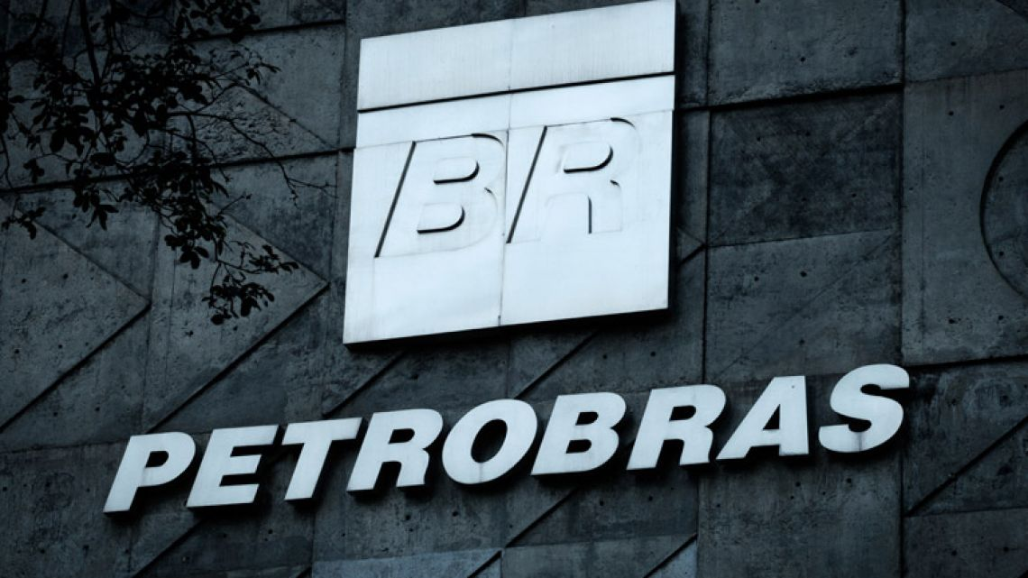 The logo of Brazilian oil company Petrobras is pictured over the entrance to its headquarters in Rio de Janeiro, Brazil.