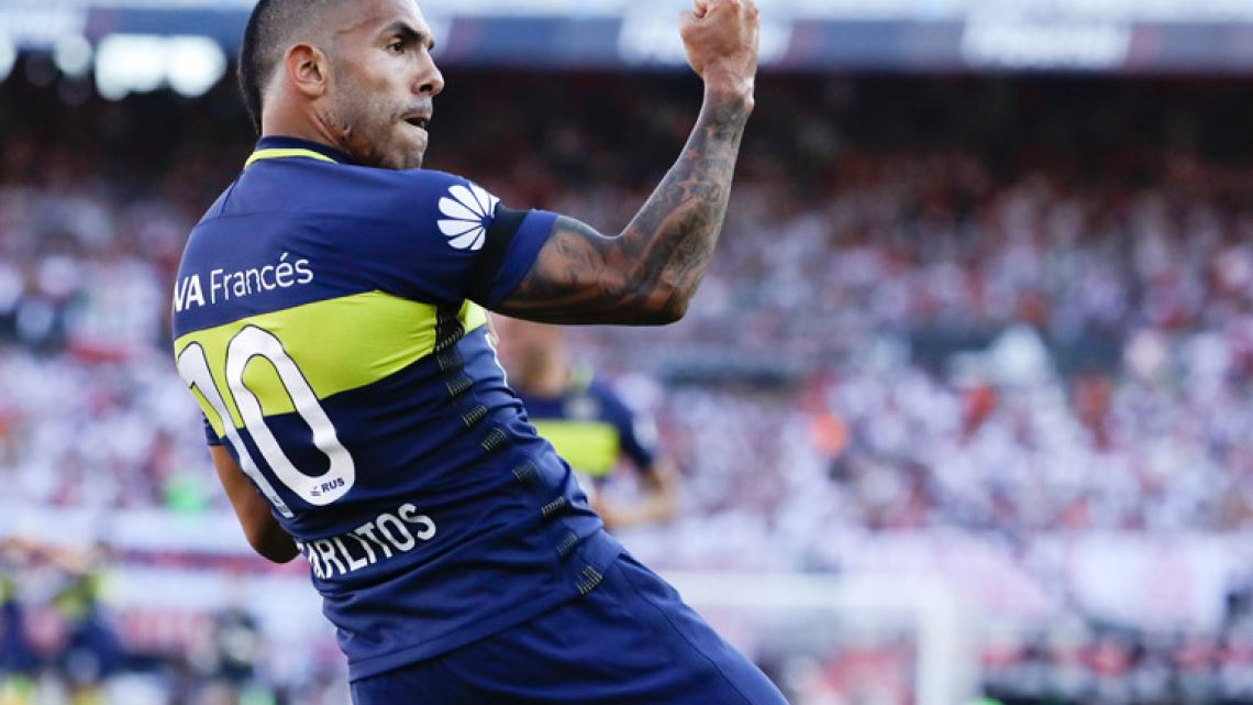 Boca Juniors' forward Carlos Tevez celebrates scoring against River Plate during a local tournament soccer match in Buenos Aires, Argentina.